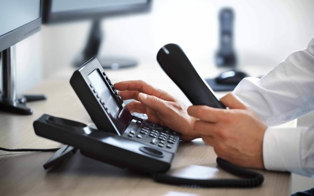 VOIP office phone system being used by worker